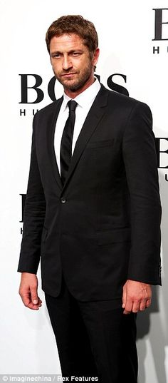 Gerard Butler in a black Hugo Boss suit at the Hugo Boss winter 2013 show in Shanghai. via dailymail.co.uk