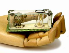 This dollhouse miniature model shows the movement of the Earth and moon. But tiny.