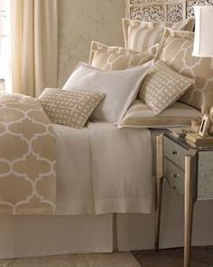 This reminds me of our bedroom only tan! Love the patterns and decor! ♥