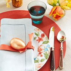 Coral accents add an unexpected pop of color to this Easter table setting. See more spring centerpieces and table settings: http://www.bhg.com/holidays/easter/decorating/easter-table-setting-ideas/?socsrc=bhgpin022313coralsetting=2