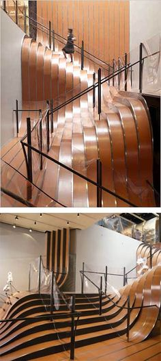 """Longchamp store, New York. Constructed in 1¼"""" hot-rolled steel, the landscape stair weighs 55 tonnes and is an installation that divides and converges to form a topography of walkways, landings and steps. The magnetic properties of the landscape stair enable movable lights and display stands to be attached with high-strength magnets."""