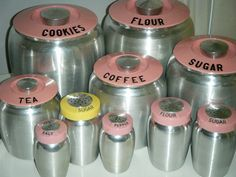 A fantastic collection of Kromex pink (and one yellow) canisters and shakers. #Kromex #vintage #kitchen #kitchenware #1950s #retro #kitsch #pink