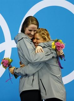 Swimming: Day 7 Finals - Swimming Missy Franklin gets a hug from Elizabeth Beisel (USA) after receiving their gold and bronze medals for the women's 200m backstroke