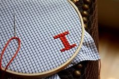 This is such a good idea! Make hankies from old shirts. What really like is using the fabric for cross stitching!