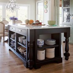 I love how they changed the style of this existing island by removing the cabinet doors. Love the open shelving look!