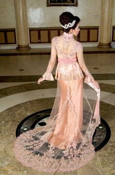 Kebaya fashion original from indonesia jaya company supplier.this kebaya like european design but this one is kebaya.with long and large trail with orange color.want it?