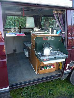 Another view of that camp stove, plus their nifty spice rack, too.