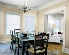 Try the Sherwin-Williams Color Visualizer to imagine what colors will look like. Use a photo of your own home, or try one of ours. Here we tried Kilim Beige (SW 6106) in a dining room.