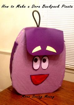 Having a Dora themed party? Make a homemade Dora Backpack Piñata!
