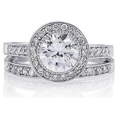 Rethinking the idea of diamond engagement rings. I don't place a huge value on diamonds, and CZ (like this) is so much more affordable for a similar look. Anyone have strong opinions on this?