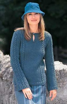 Beautiful keyhole-neck tunic features cable patterning and relaxed, easy style. Sizes XS-XL (32-40 in/81 to 102 cm bust). Shown in Patons Classic Wool #77115 New Denim, using 4 mm ( US 6) and 4.5 (US 7) knitting needles.