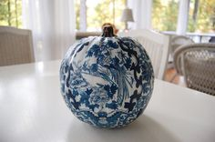 This blue & white decoupage pumpkin looks like fine china — tutorial on how to decoupage with any pattern you want to perfectly match your room's decor!