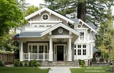 Check out the stone risers of this porch. I love it, I want to do it. The pretty white, over-the-door arbors are on my wish list, as well!