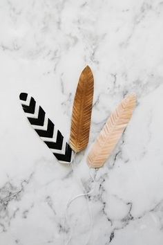diy washi tape feathers. would make a lovely garland