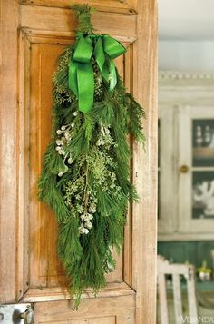 Christmas Wreaths cabinets, green, christma decor, front doors, bow, happy holidays, christmas swags, wreaths, the holiday