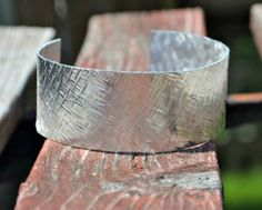 The 10 Minute Textured Cuff is beautiful in its simplicity. This tutorial on how to make a cuff bracelet shows you an easy stamping technique that creates delicate lines on the metal band. Not only is this DIY bracelet a cinch to make, but it looks great dressed up or down.