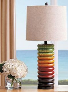 The Nora Table Lamp's colorful base brings new life and excitement while shining a glowing light in any room.