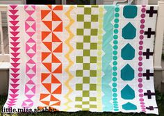 Sewing a quilt has never been more exciting than with this Coolest Ever Rainbow Quilt. This amazing quilt pattern has different shapes in each row, which gives it a one-of-a-kind feel. Read more at http://www.favequilts.com/Throws-and-Lap-Quilts/Coolest-Ever-Rainbow-Quilt#kcMIaL0GAOGPeZmA.99