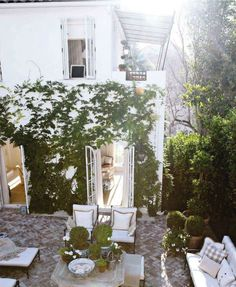 """New Traditional"" home of Mark D. Sikes, an LA based visual merchandiser, via House Beautiful #backyard #patio"