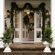 Merry and Bright Family Home | See All of Our Holiday Homes | SouthernLiving.com  A gorgeous timeless entry for the holidays!