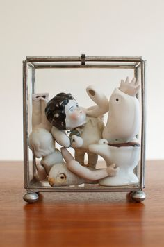 Antique Porcelain German Doll Head Body Parts in Metal & Glass Display Case. $55.00, via Etsy.