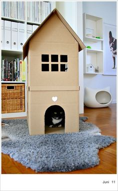 Cat House by chezlarsson: Crafted out of cardboard boxes ~ have to try to build this!