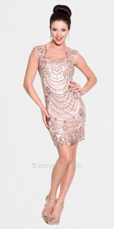 This bead and sequin accented cocktail dress by Atria has cap sleeves and slight v-neckline. The back has a large circu....Price - $328.00 - D2nXygTm