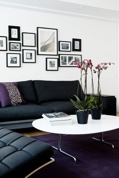 I love this black, white and purple living room. Image from KML Design.