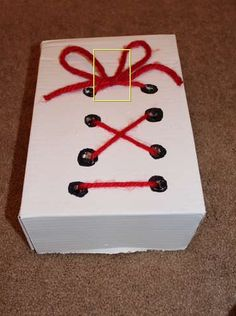 Make a Box to Practice Tying Shoes and Making Bows