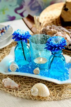 Really cute beach wedding reception table centerpiece - http://casualweddingdresses.net/beach-wedding-ideas-be-a-stunning-beach-bride-on-your-own-beach-wedding/