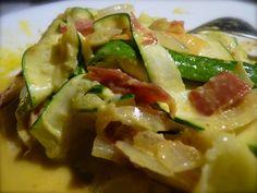 Enjoy fresh zucchini noodles with flavorful creamy carbonara sauce