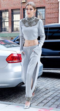 Gigi Hadid's sweatsuit costs more than our rent. - celebrity street style - embellished grey sweatshirt and sweatpants outfit