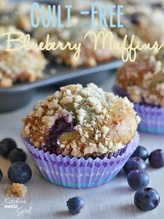 Guilt Free Blueberry Muffin from www.kitchenmeetsgirl.com - bursting with blueberries and a cinnamon struesel topping, these muffins are just 6 WW points+ each!