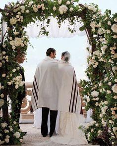 Under the chupah at a Jewish wedding
