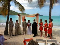 Love her wedding gown and the orange color! and its in St Thomas!!!!!