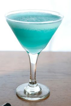 Blue Hawaiian Cocktail ~ A Year of Cocktails  1 shot light rum 1/2 shot blue Curaçao 2 shots pineapple juice 1 shot cream of coconut