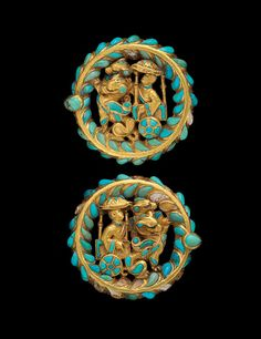 Boot Buckles w/ Carriages Drawn by Dragons  --  2nd quarter, 1st Century CE  --  From Tomb IV, Tillya Tepe, Afghanistan  --  No further reference provided.