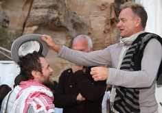 Sting and Jovanotti fool around back stage at a Memorial Concert to Luciano Pavarotti at Little Petra to celebrate the life of the singer as part of the Salute Petra event on October 12, 2008 in Petra, Jordan.