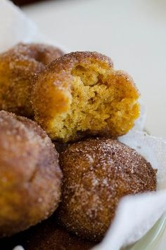 For the donuts:     1 3/4 cups all-purpose flour     2 teaspoons baking powder     1/2 teaspoon salt     1/2 teaspoons cinnamon     1/2 teaspoons nutmeg     1/2 teaspoon allspice     1/8 teaspoons ground cloves     1/3 cup vegetable oil     1/2 cup brown sugar     1 egg     1 teaspoon vanilla extract     3/4 cup pumpkin puree (not pumpkin pie filling)     1/2 cup low-fat milk     For the Coating:     1 stick of unsalted butter, melted     2/3 cup granulated sugar     2 tablespoons cinnamon