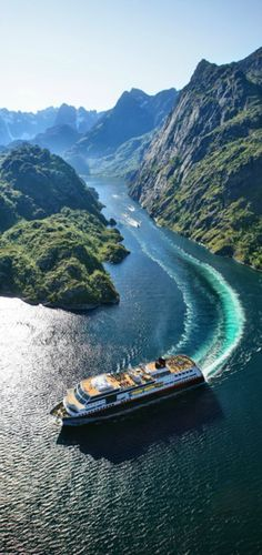 Highways in northern Norway ~ Hurtigruten sails out of Trollfjord • Photo: ToFoto