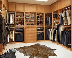 Light Wood. Very Large Male and Female. Some good Ideas. Varied Layout. U Shaped. Good space at top. Large Wood U Shaped Male and Female Varied Design  California Closets link: http://www.californiaclosets.com/files/image_hero/Bedroom-18.jpg chopped at top.