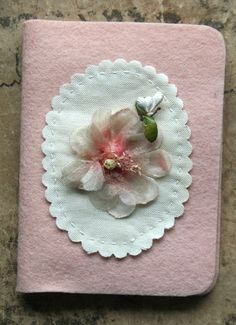 Another idea to use felt for covering small notebooks for gifts.  (Julie Collings needle book.)