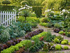 veggie garden intermingled with brick paths and flowers