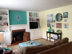 Wall art design complete for living room with photos by laura Winslow photography frames by homegoods