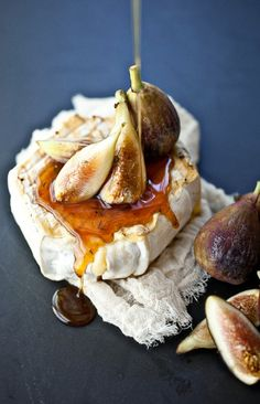 1 small wheel of soft cheese( brie or a triple cream),1/4 c honey,2 sprigs of thyme,fresh figs  In a small saucepan add the honey and thyme and heat on lowtill warm.Remove and set aside,Preheat a grill  until very hot. Place the cheese on the grill and sear, about 1-2 minutes on each side.Transfer cheese to your serving platter. Half and quarter several figs and place on top of the grilled cheese. Drizzle the figs and cheese with the honey.Serve immediately with crackers and/or bread