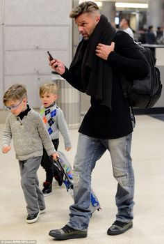 Ricky Martin has been busy carrying on with his duties as a devoted father. The singer was seen on Sunday, stepping out with five-year old twins Matteo and Valentino for the first time since the split at LAX. Read more: http://www.dailymail.co.uk/tvshowbiz/article-2534749/Ricky-Martin-steps-children-Matteo-Valentino-time-split-partner-Carlos-Gonzalez.html#ixzz2qAbb6cJy  Follow us: @MailOnline on Twitter | DailyMail on Facebook