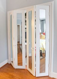 Adding slim full-length mirrors to flat closet doors and trimming them out with molding is a great way to bring a contemporary vibe to a room and make it seem larger.