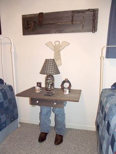 This is a fun western side table made by Mary Francis and Jack. They took some old boots and jeans, reinforced with a 2x4 and used some old barn wood for the top
