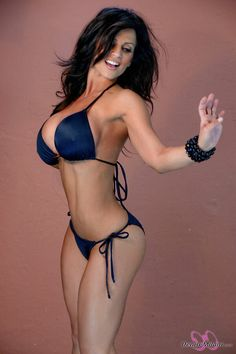 Denise Milani Damn!  She actually has a flaw chunky fingers. :-)