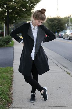 A Gap white oxford paired with black jeans is an easy, go-to look this season. Blogger The Locus of Style adds a black trench, statement necklace, and sneakers to the look for a clever mix of high and low.